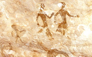 Algeria: Neolithic rock painting depicting human figures and a magnificent mouflon head
